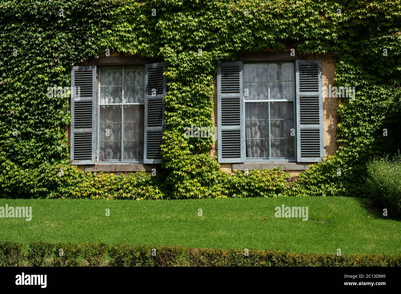 Outside view of Ivy covered  and lush garden at Overnewton Castle a heritatge listed property near Melbourne. Stock Photo