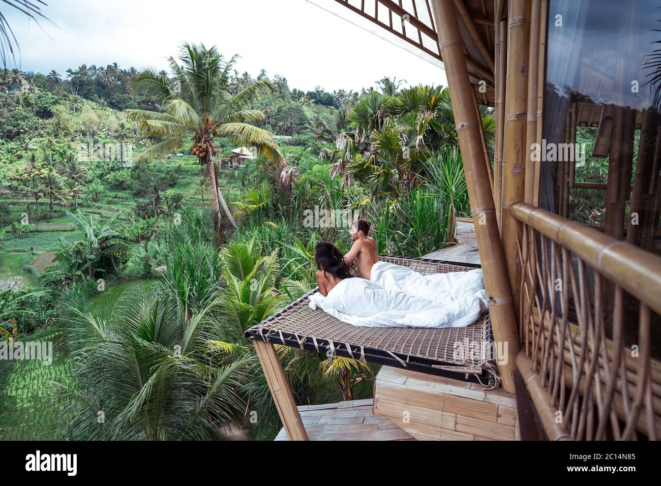 Couple Enjoying Morning Vacations On Tropical Jungle Villa Bungalow Looking Palms Relaxing Holiday At Bali Indonesia Couple On Their Honeymoon Stock Photo Alamy