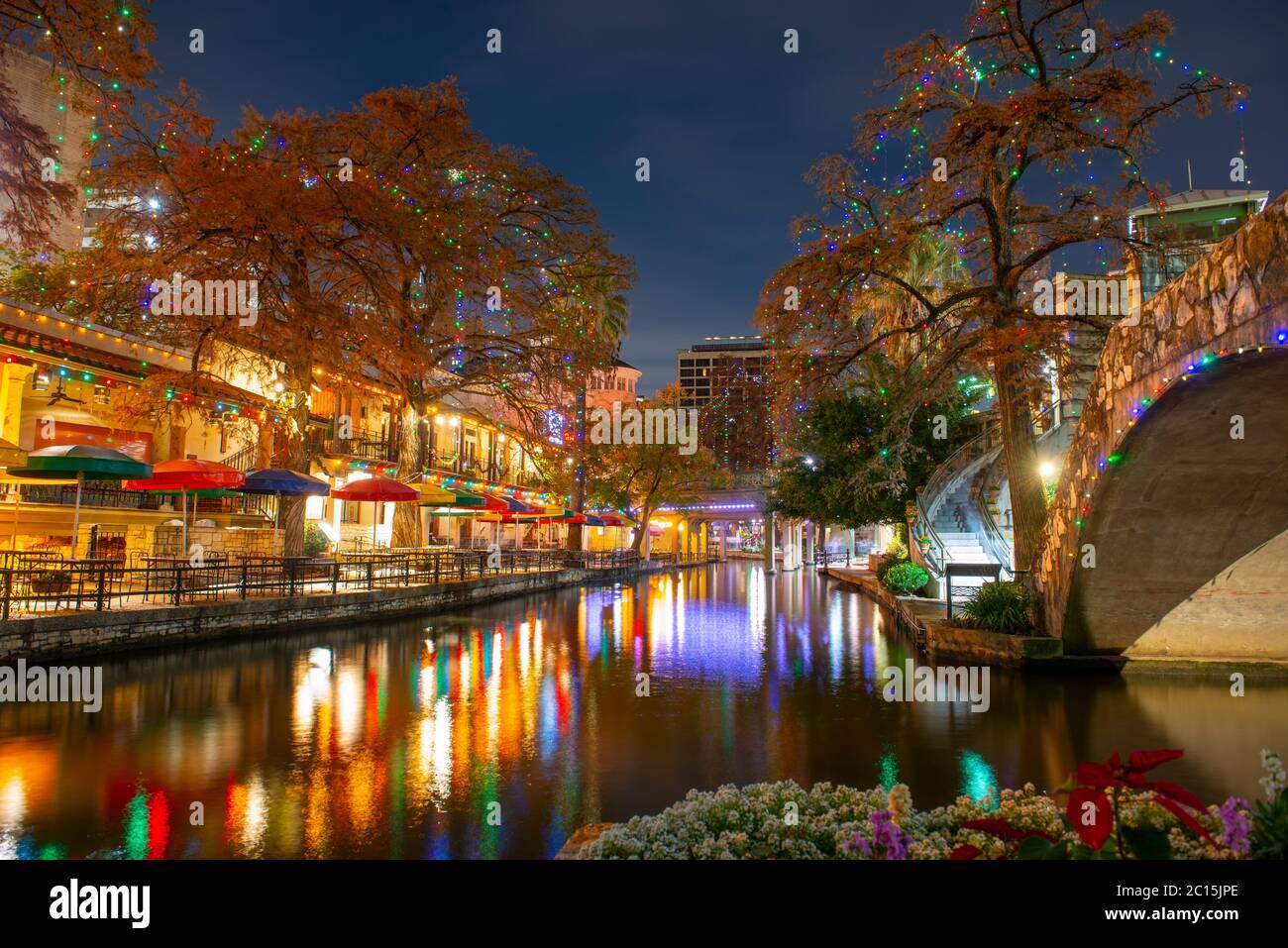 San Antonio River Walk and stone bridge over San Antonio River near Alamo in downtown San Antonio, Texas, USA. Stock Photo