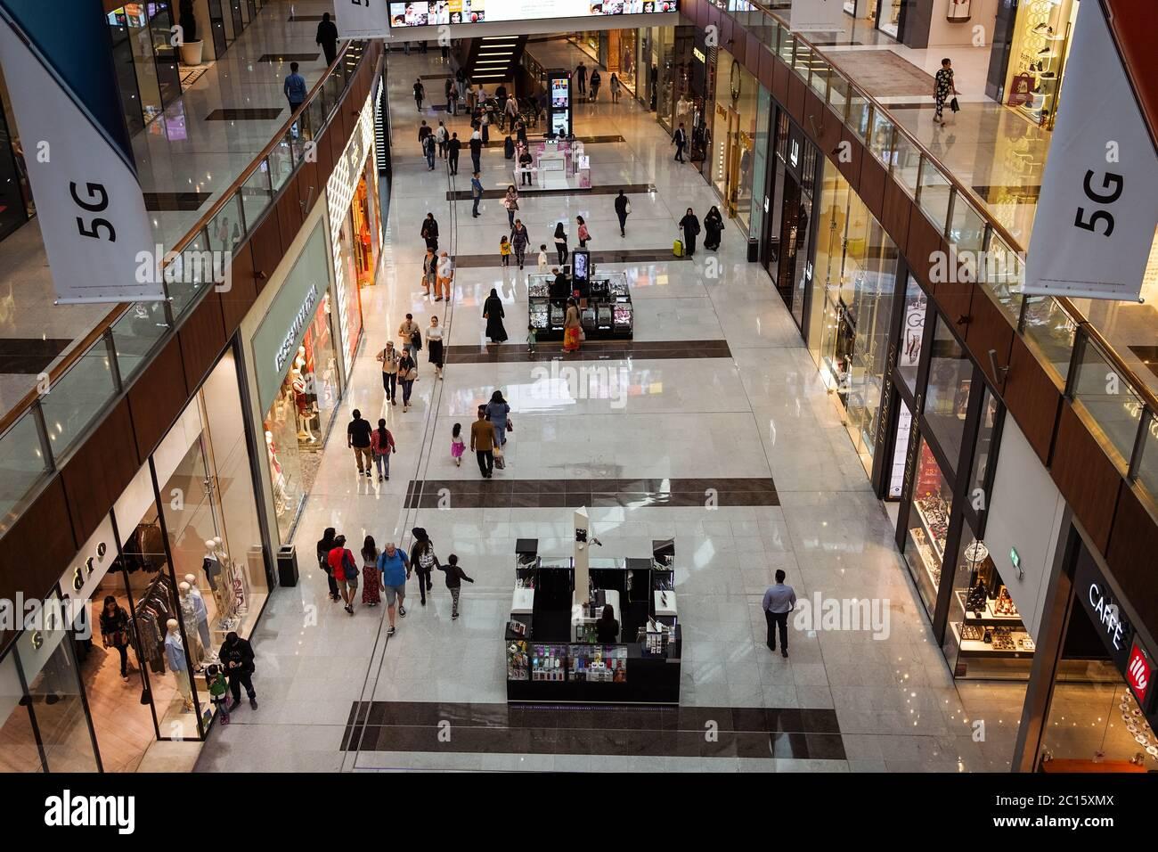 Dubai / United Arab Emirates - February 1, 2020: Indoor photo of Dubai Mall with multi ethnic crowd of tourists shopping on it Stock Photo