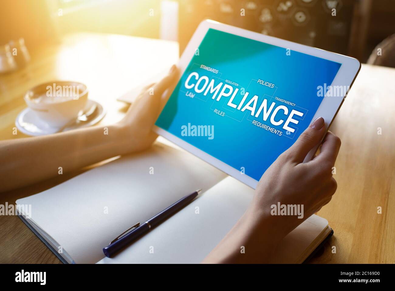 Compliance concept with icons and diagrams. Regulations, law, standards, requirements, audit. Concept on device screen Stock Photo