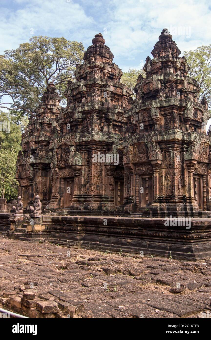 Prasats, or chapels, at the ancient Khmer temple of Banteay Srei, Angkor, Cambodia. Stock Photo