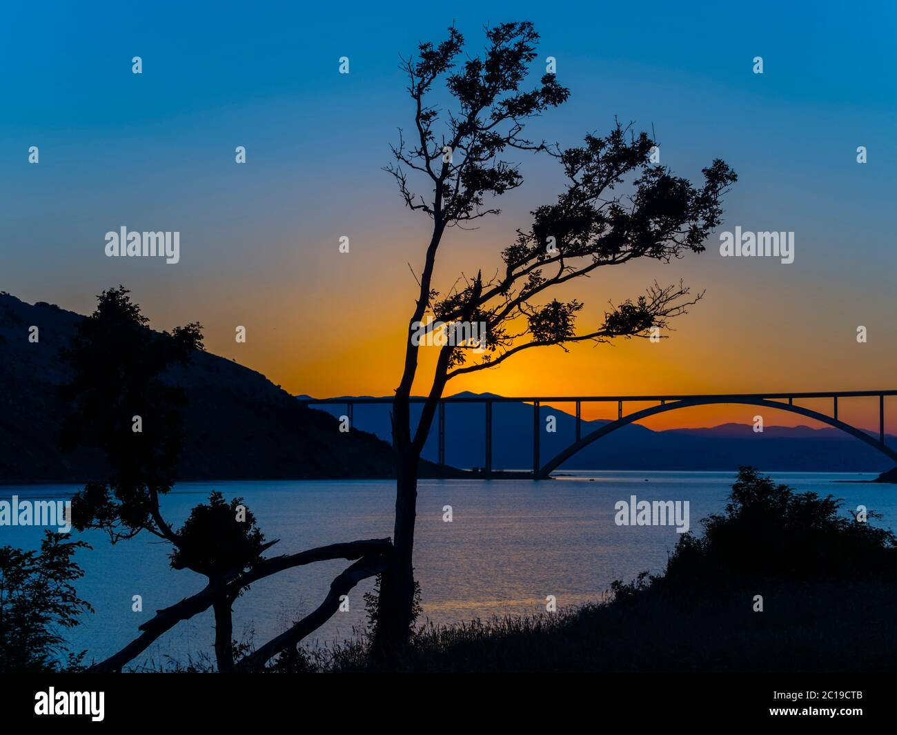 Sunset dusk landscape bridge mainland to island Krk Croatia Stock Photo