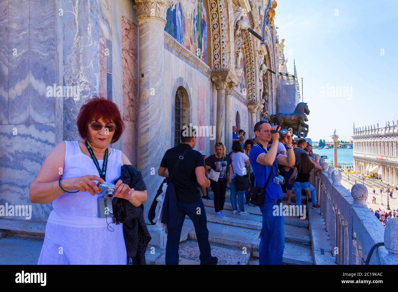 Tourists enjoying the view from the St Mark`s Basilica balcony, Metropolitan city of Venice,Italy,June 7th 2016 Stock Photo