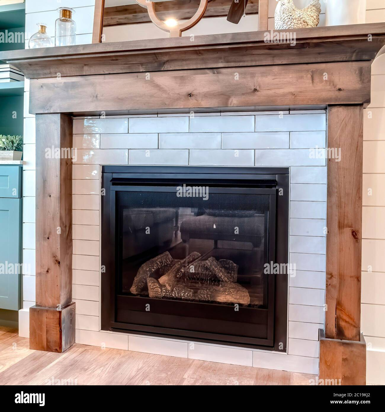 Square Interior Of Living Room With Fireplace And Fitted Display And Storage Cabinet Stock Photo Alamy
