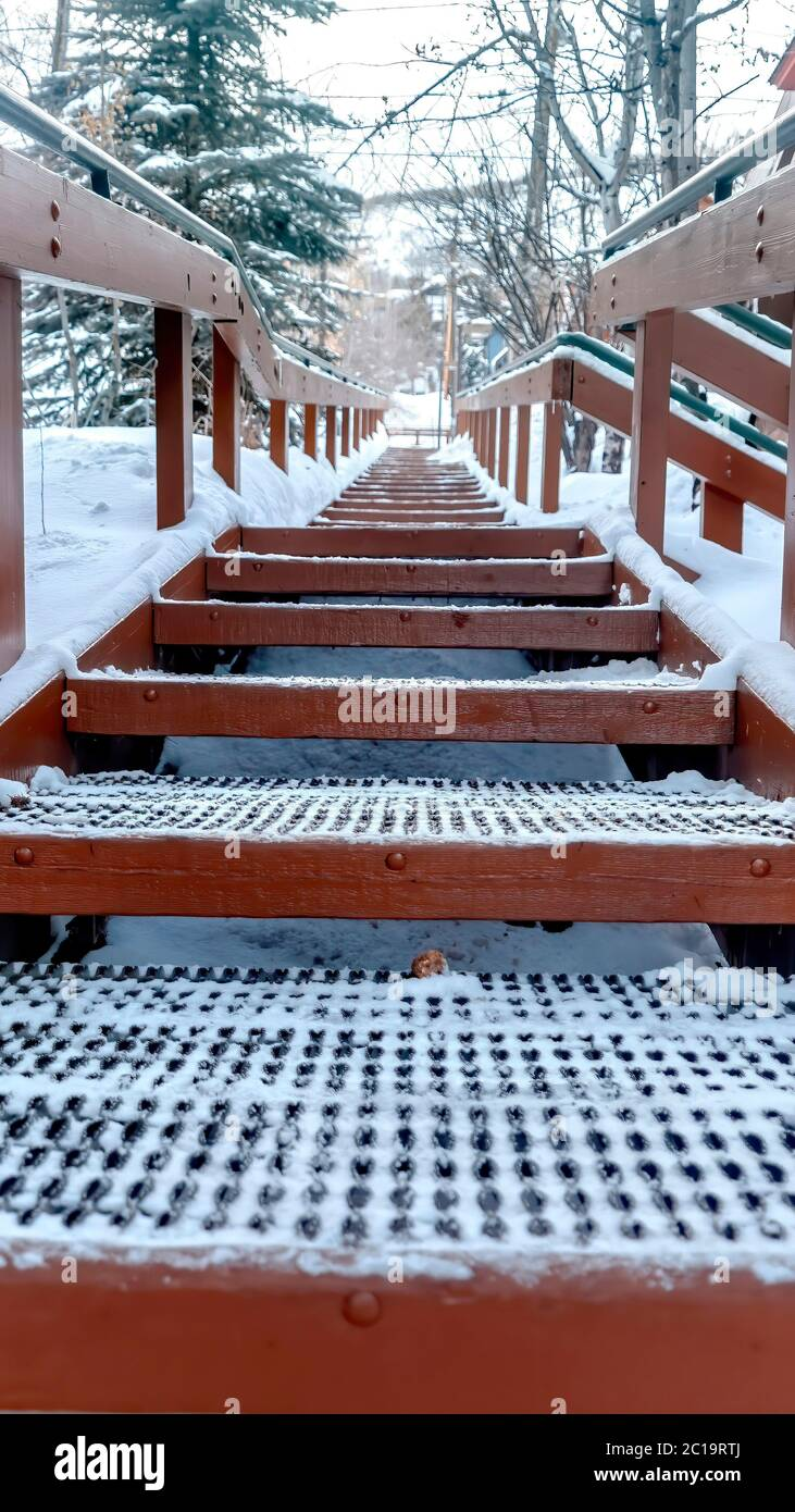 Image of: Vertical Crop Focus On Grate Metal Treads Of Outdoor Stairs Against Snowy Hill In Winter Stock Photo Alamy
