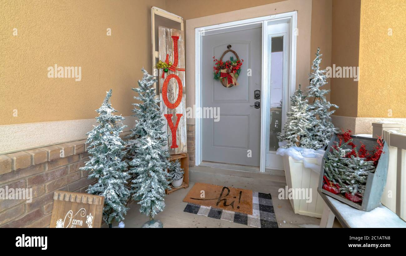 Panorama Festive Home Entrance With Christmas Trees Holiday Decorations And Basket Wreath Stock Photo Alamy