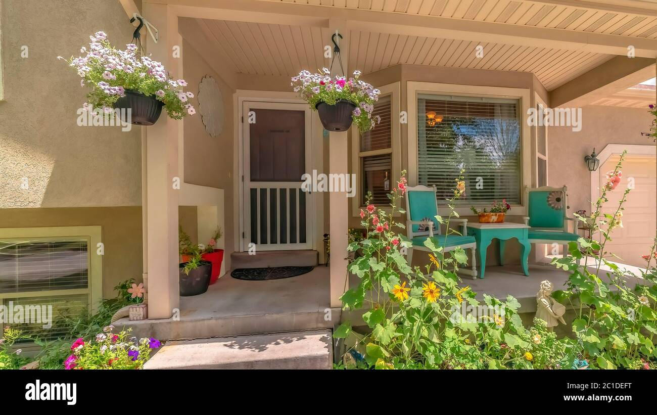 Panorama Home Exterior With Bay Window On Front Porch Decorated With Flowers And Plants Stock Photo Alamy