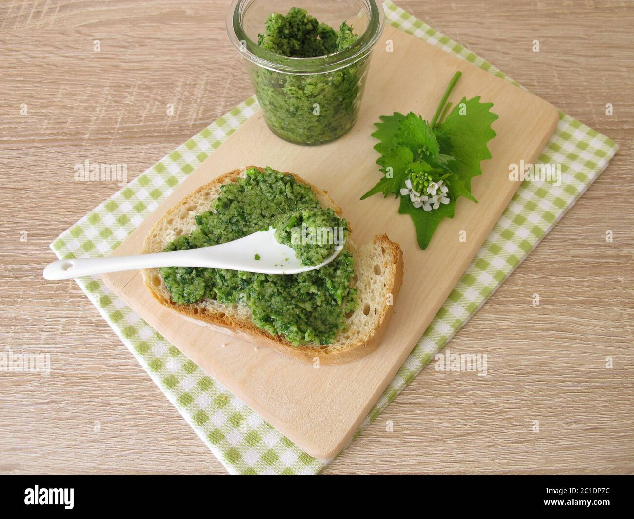 Homemade garlic mustard pesto on baguette Stock Photo
