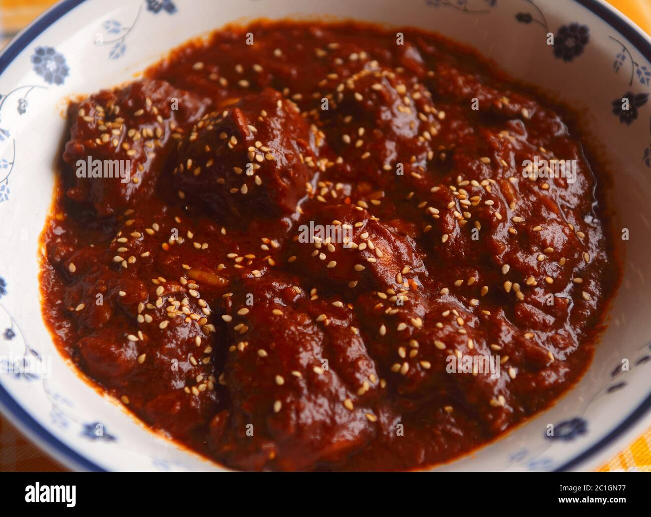 Chicken in spicy chocolate Mole Poblano sauce - famous typical Mexican dish from Puebla. (selective focus) Stock Photo
