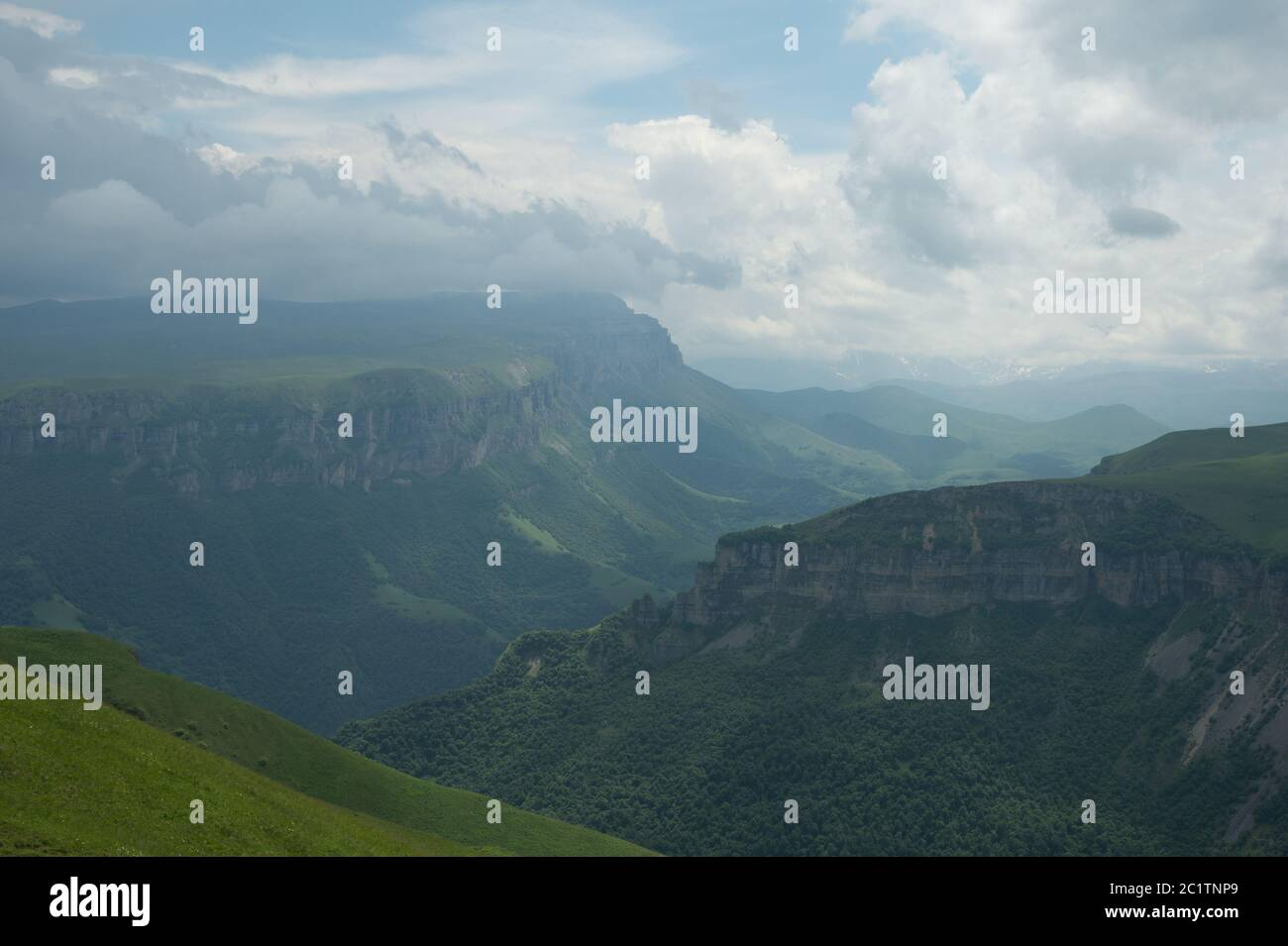 Dramatic landscape of a green valley at the foot of the Inal Plateau in the North Caucasus Stock Photo