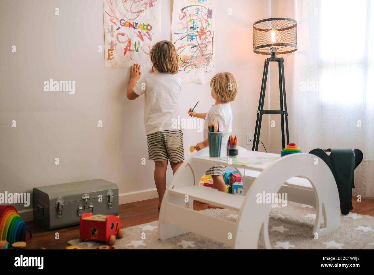 Little blond children plays painting at home. entertainment during quarantine. family at home coronavirus. Stock Photo