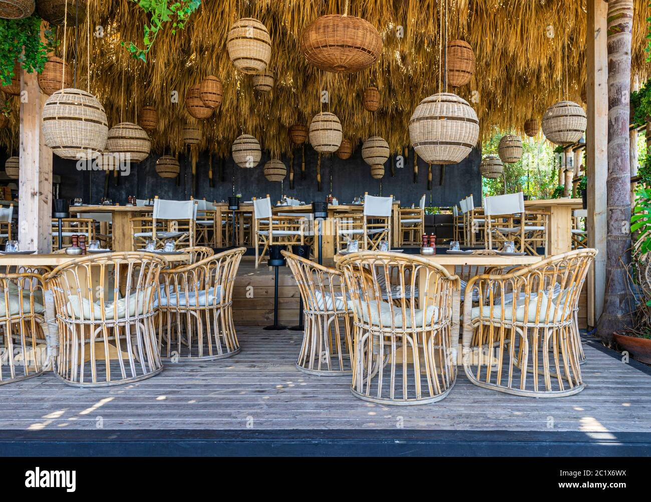 Cafe Restaurant Decorated With A Bamboo Rattan Furniture Design And Hanging Grass Ceiling Stock Photo Alamy