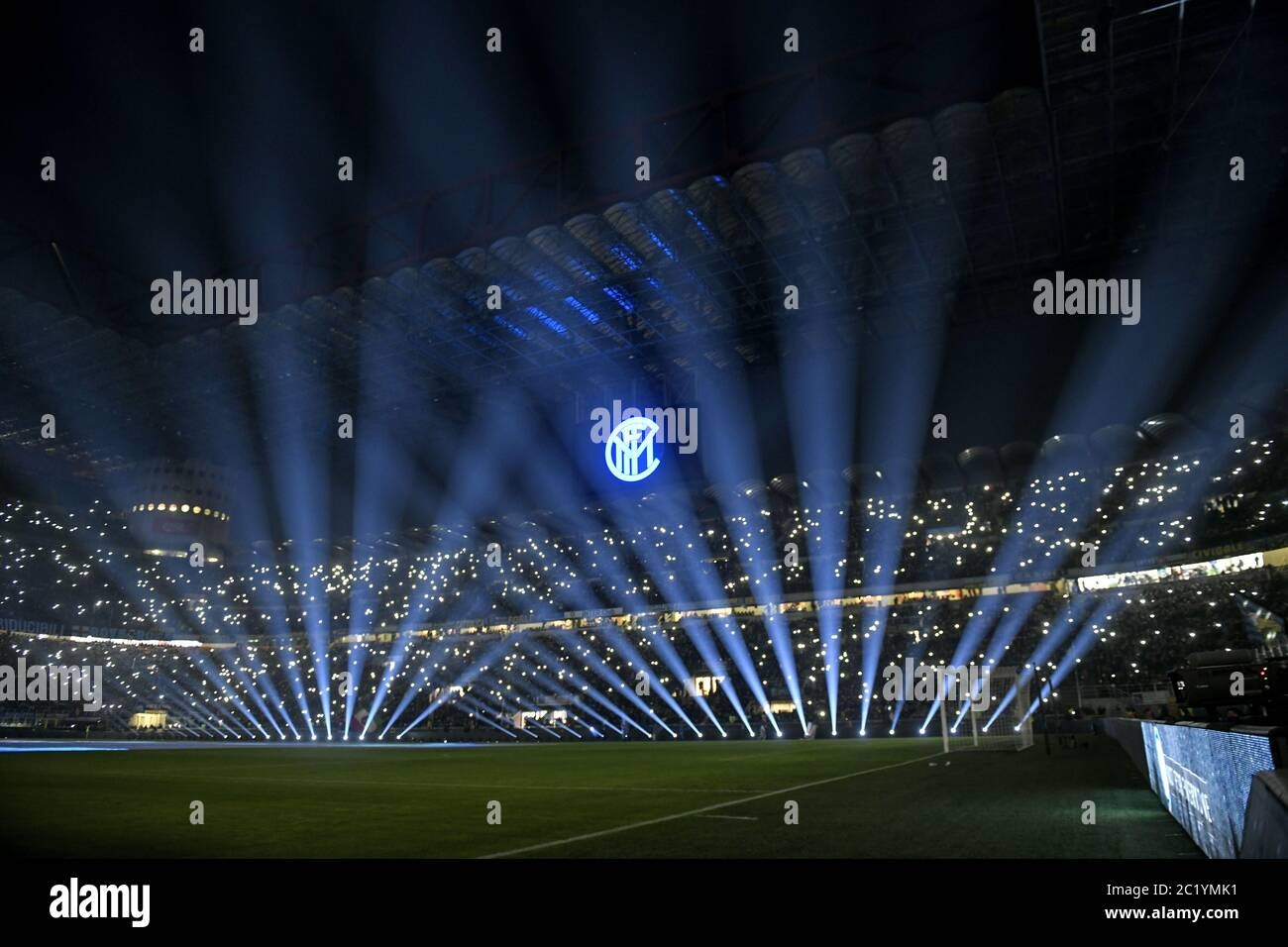 Blue lights and smatphone lights in the dark of the san siro football stadium, before Inter Milan's soccer players enter on the pitch, in Milan. Stock Photo