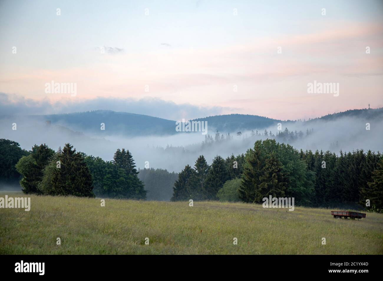 June 12th, 2020, Schwithten (Hessen): Fog lies in the early morning over the fields and the forest at Schwithten Seelenberg.   usage worldwide Stock Photo