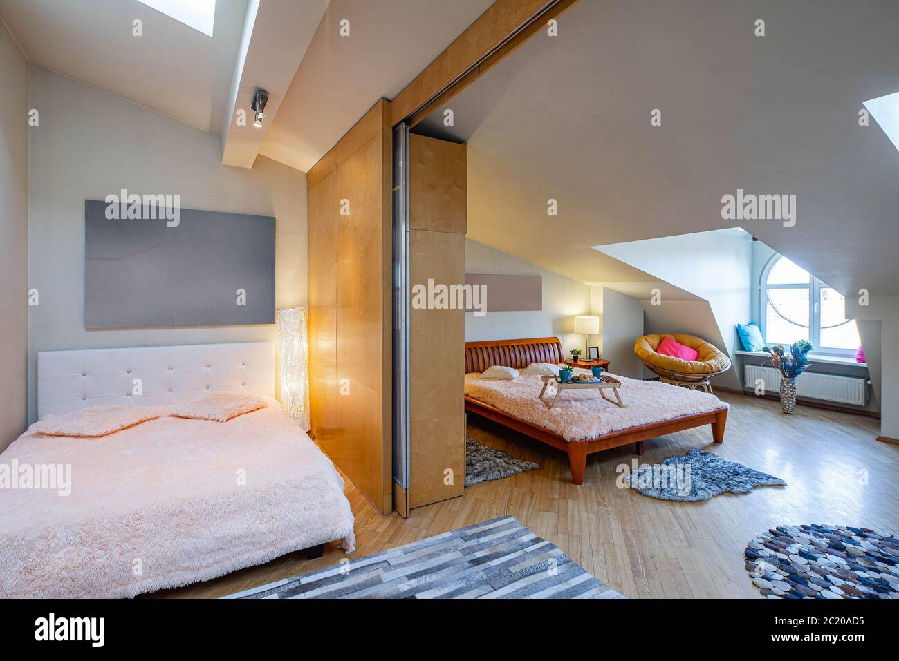 Modern Interior Of Spacious Bedroom With Two Beds Luxury Apartment Roof Windows Wooden Furniture Zoning Stock Photo Alamy