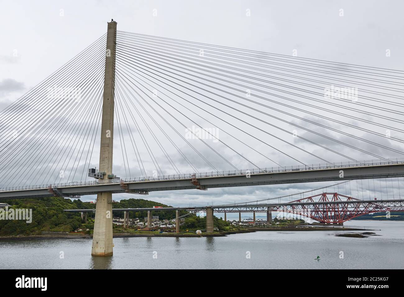 The new Queensferry Crossing bridge over the Firth of Forth with the older Forth Road bridge and the Stock Photo