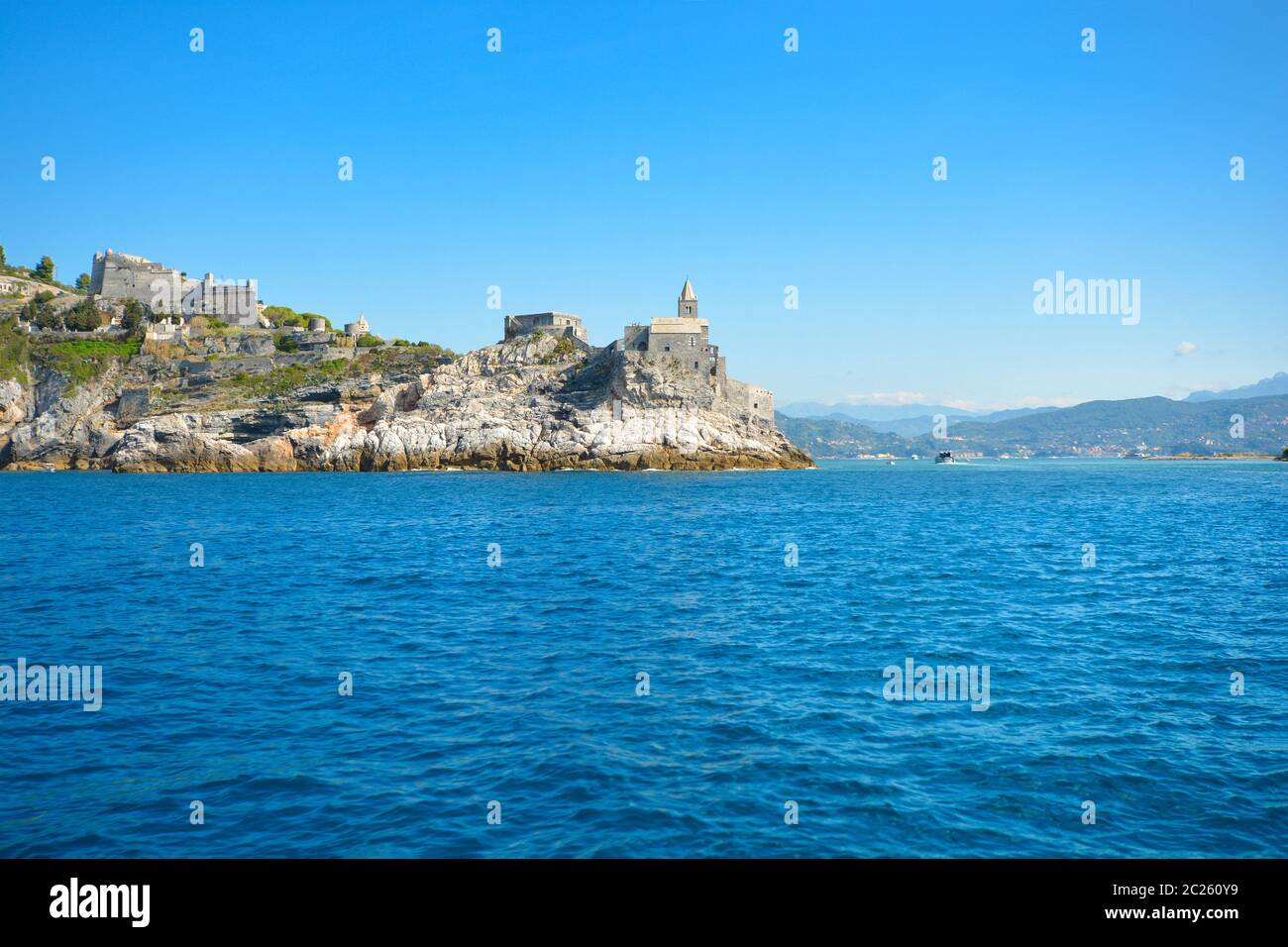 The gothic Church of St Peter and Doria Castle on the rocky peninsula at the entrance to the gulf of Poets at Porto Venere Italy on the Ligurian Coast Stock Photo