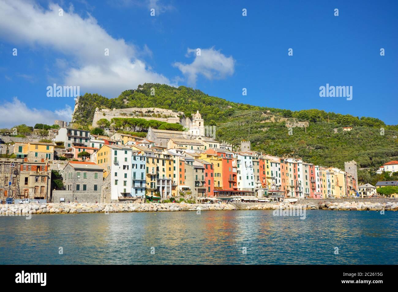The colorful coastal village of Porto Venere, Italy, on the Ligurian coast, with it's sidewalk cafes, shops and marina. Stock Photo