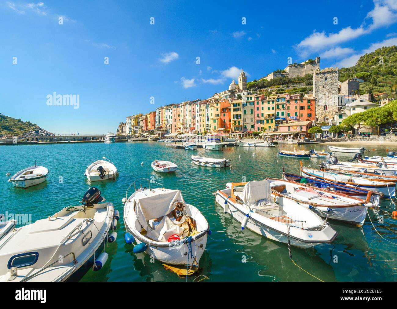 Colorful sea and village of Portovenere, Italy, with it's harbor, pier, cafes and ancient fort and castle on the Ligurian Coast of Italy Stock Photo