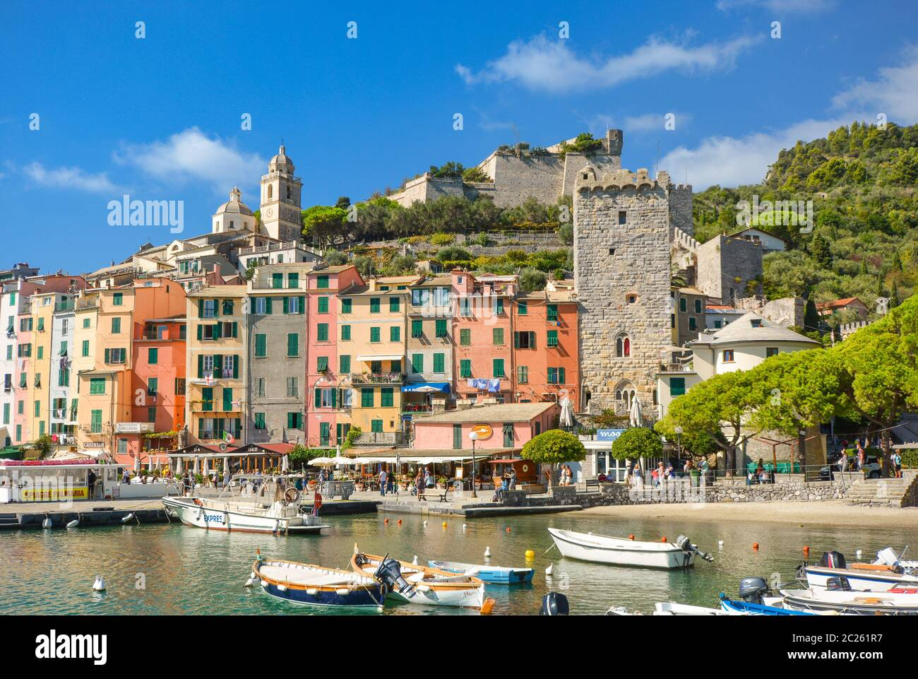The colorful seaside village, harbor, bay and beach of Portovenere, Italy, an Unesco World Heritage site on the Ligurian coast Stock Photo