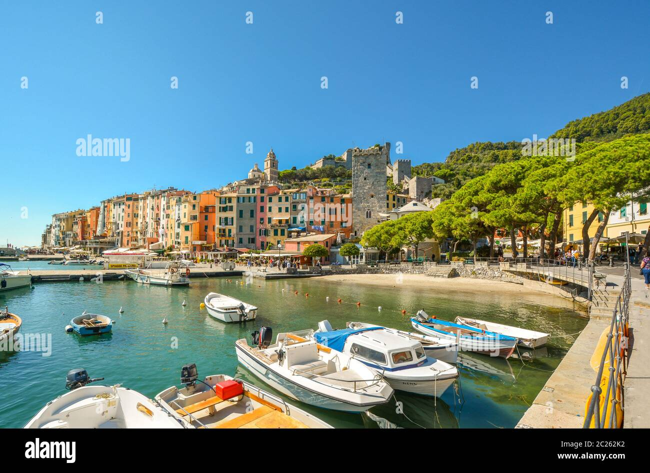 The colorful village, marina, sea, boats and sandy beach at Portovenere, Italy, along the Ligurian coast of the Cinque Terre and Gulf of Poets. Stock Photo