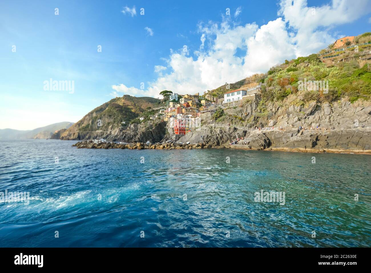 The rocky coastline of Riomaggiore, Italy, part of the five fishing villages that make up the Cinque Terre on the Ligurian coast of Italy. Stock Photo