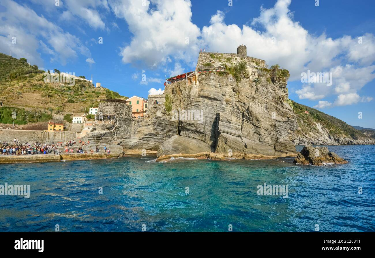 The Castello Doria, the ancient fort along the Ligurian Coast is visible from the sea at the fishing village of Vernazza, Italy, Cinque Terre Stock Photo