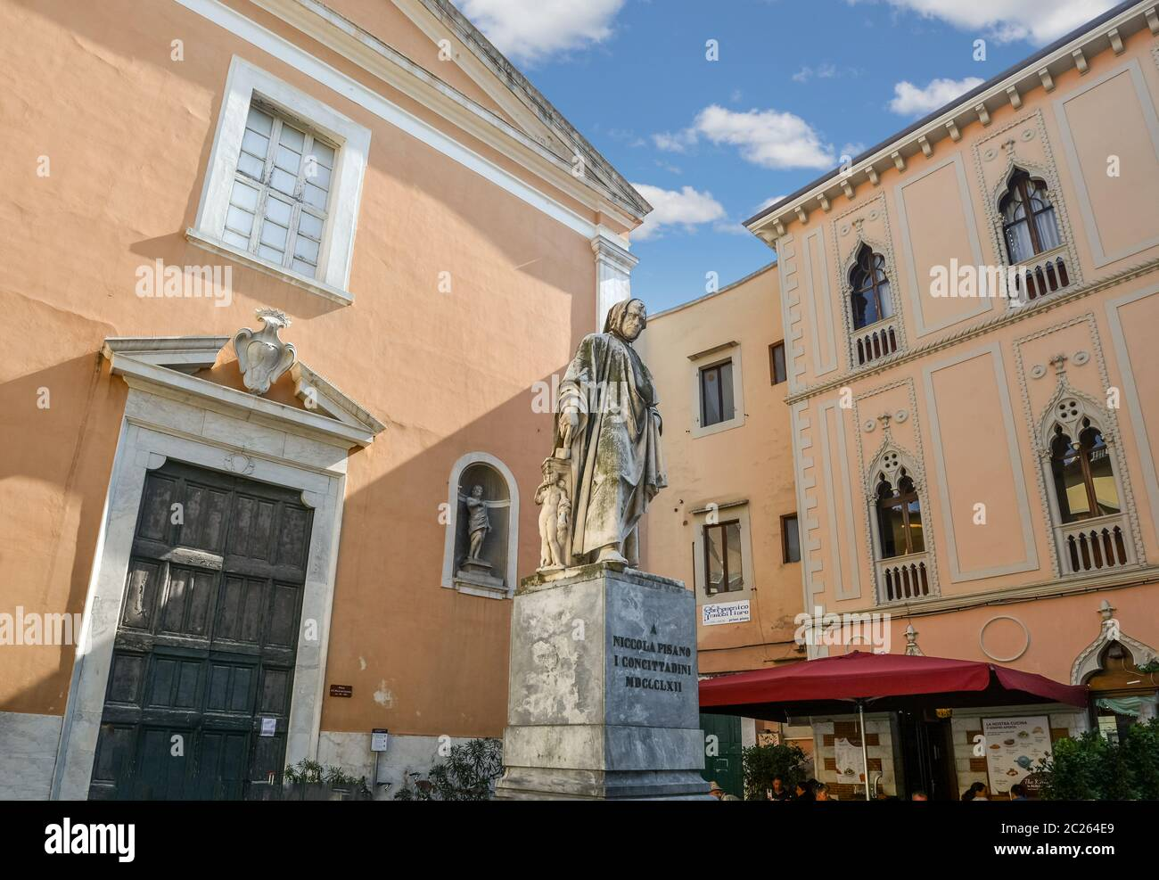 Statue of Italian sculptor Nicola Pisano in a small piazza in the Tuscan city of Pisa, Italy Stock Photo