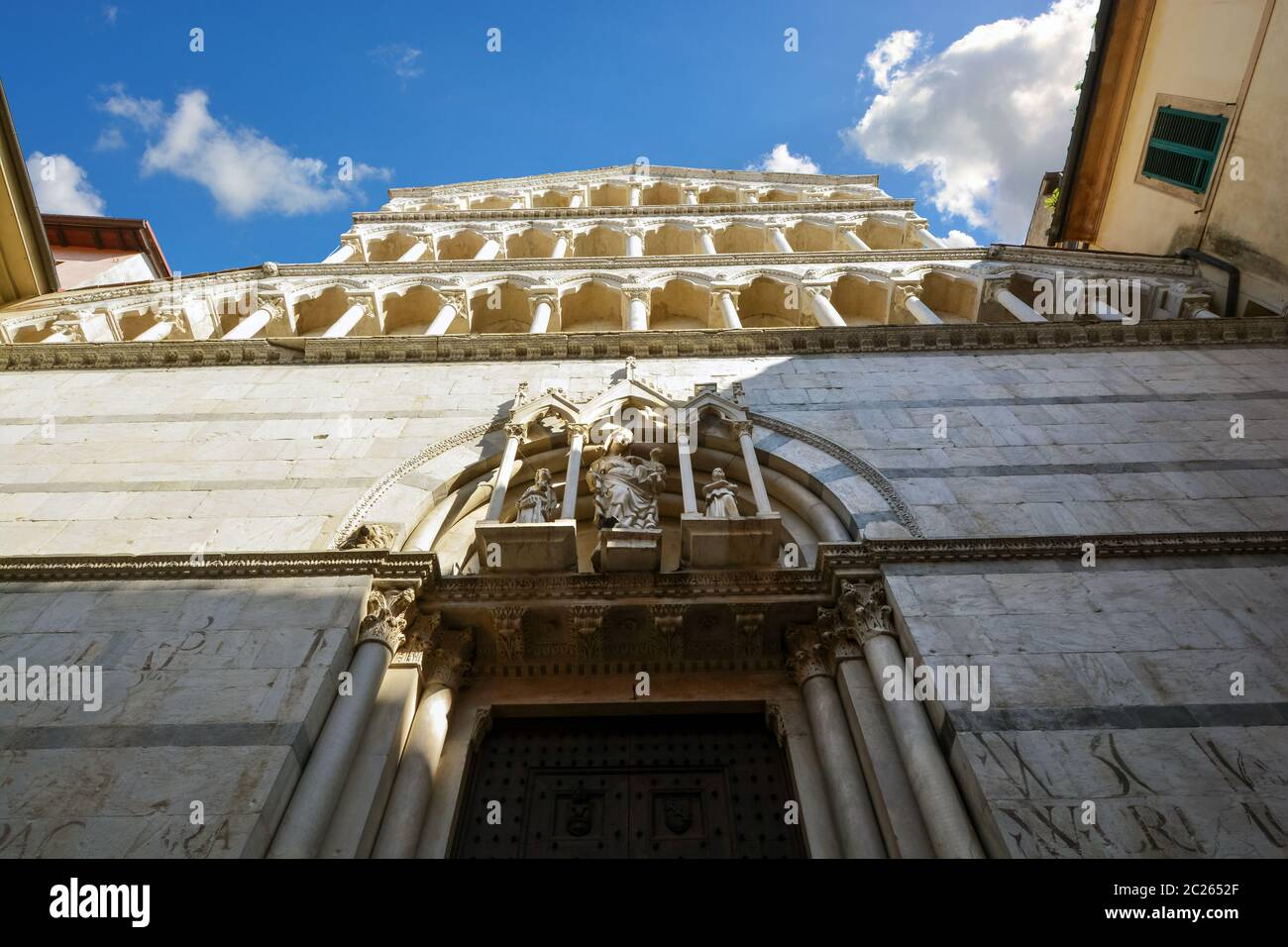 The facade of the church and monastery of San Michele in the Tuscan city Borgo in Pisa Italy Stock Photo