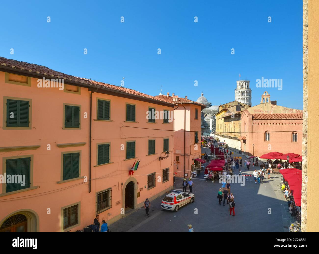 Tourists and cafes on the Via Santa Maria, the busy tourist street leading to the Leaning tower in the Tuscan city of Pisa, Italy Stock Photo