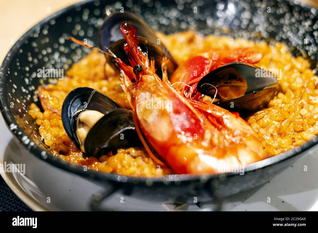 Paella with mariscos, a typical dish of traditional Spanish cuisine based on seafood and rice Stock Photo