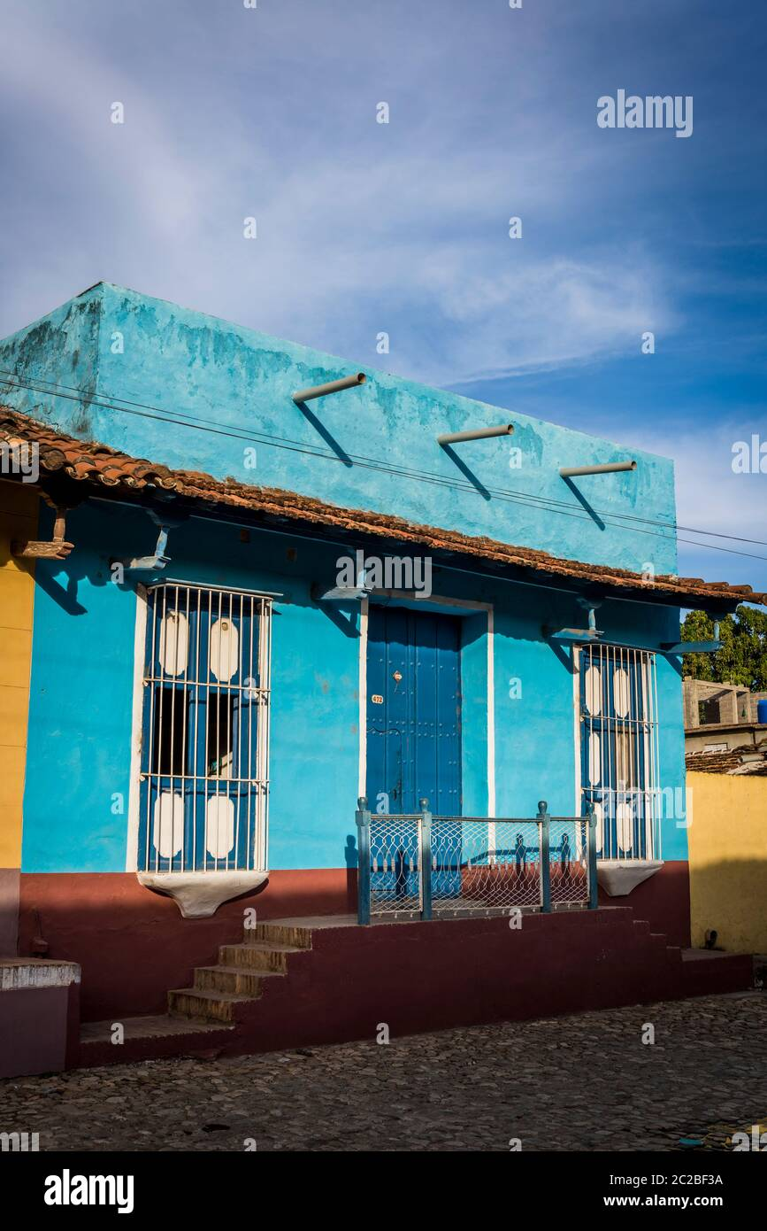 Empty cobblestone street and quaint Spanish style colonial architecture in Santa Ana residential neighbourhood of the city centre, Trinidad, Cuba Stock Photo