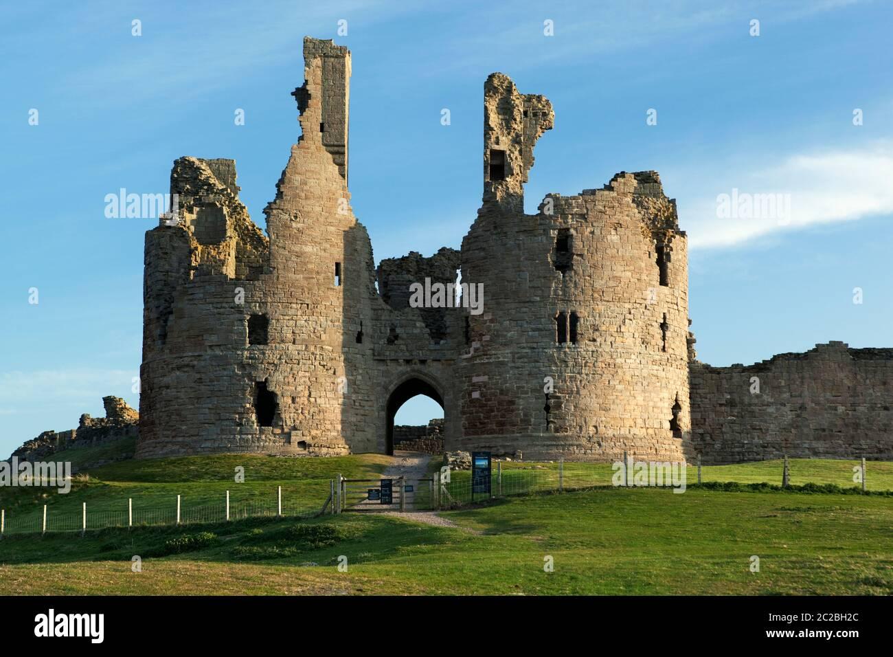 Ruins of medieval Dunstanburgh Castle, Alnwick, Northumberland, England, United Kingdom, Europe Stock Photo