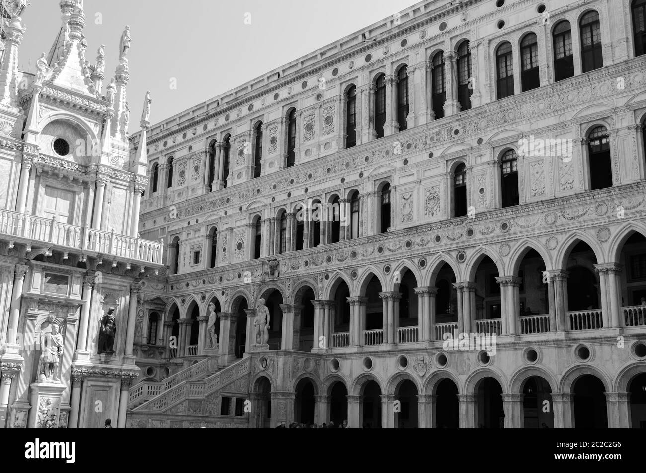 Black and white ornamental structure located near arched walls in courtyard of medieval Doge Palace in Venice, Italy Stock Photo