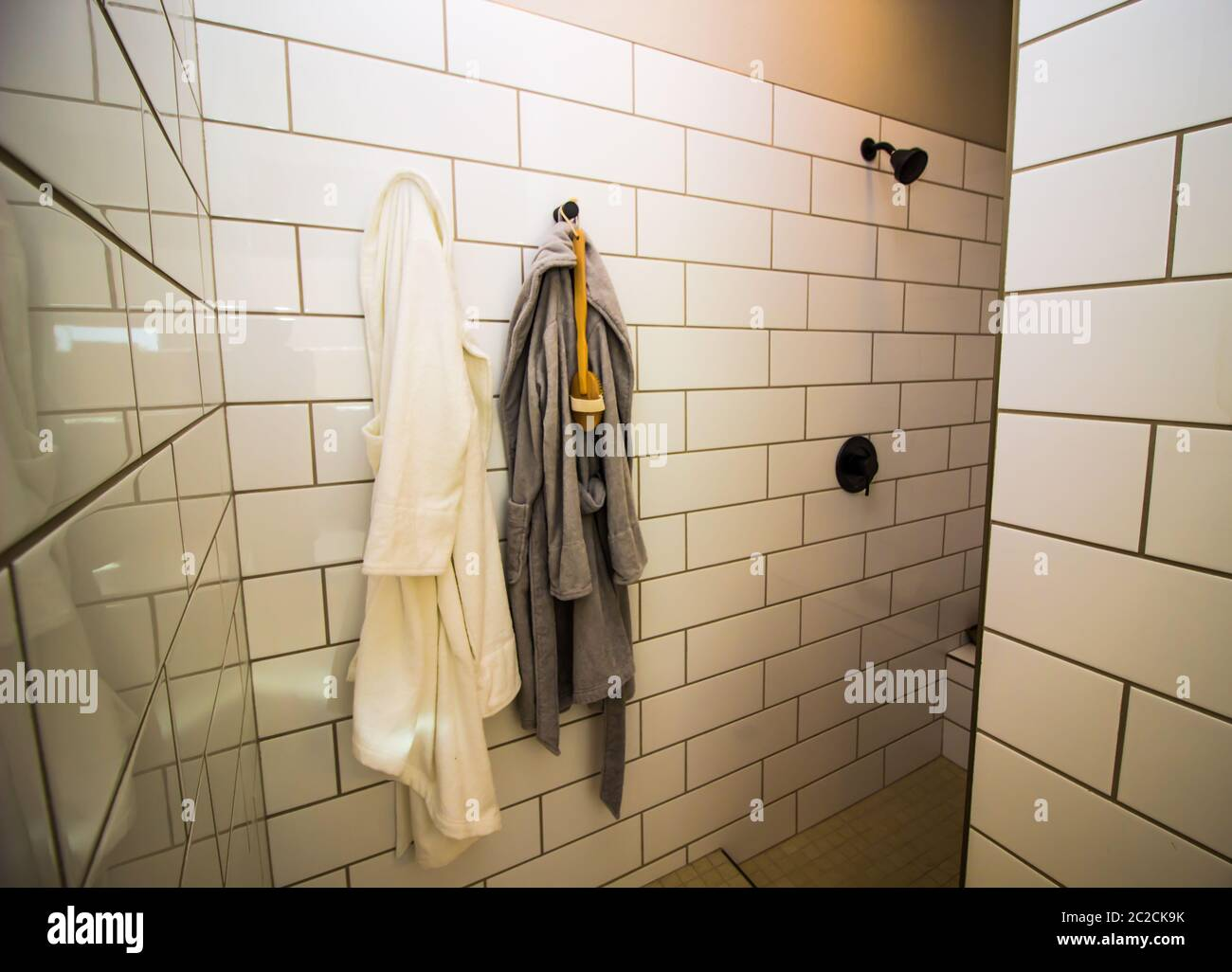 Modern Walk In Shower With Hanging Robes Stock Photo Alamy