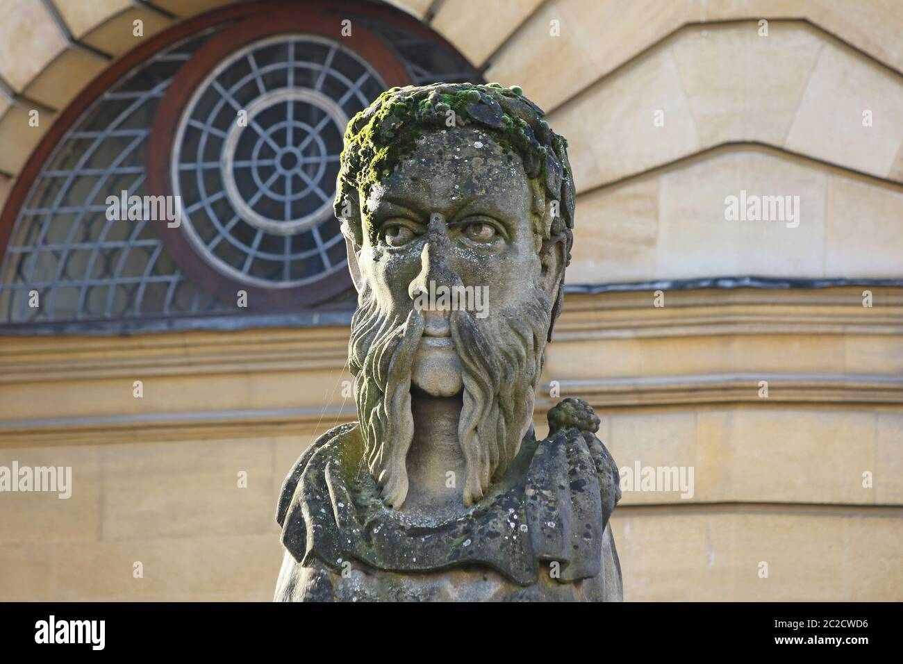 One of 17 different carved heads outside the Sheldonian Theatre and history of science museum in Oxford called Emperor Heads but probably philosophers Stock Photo