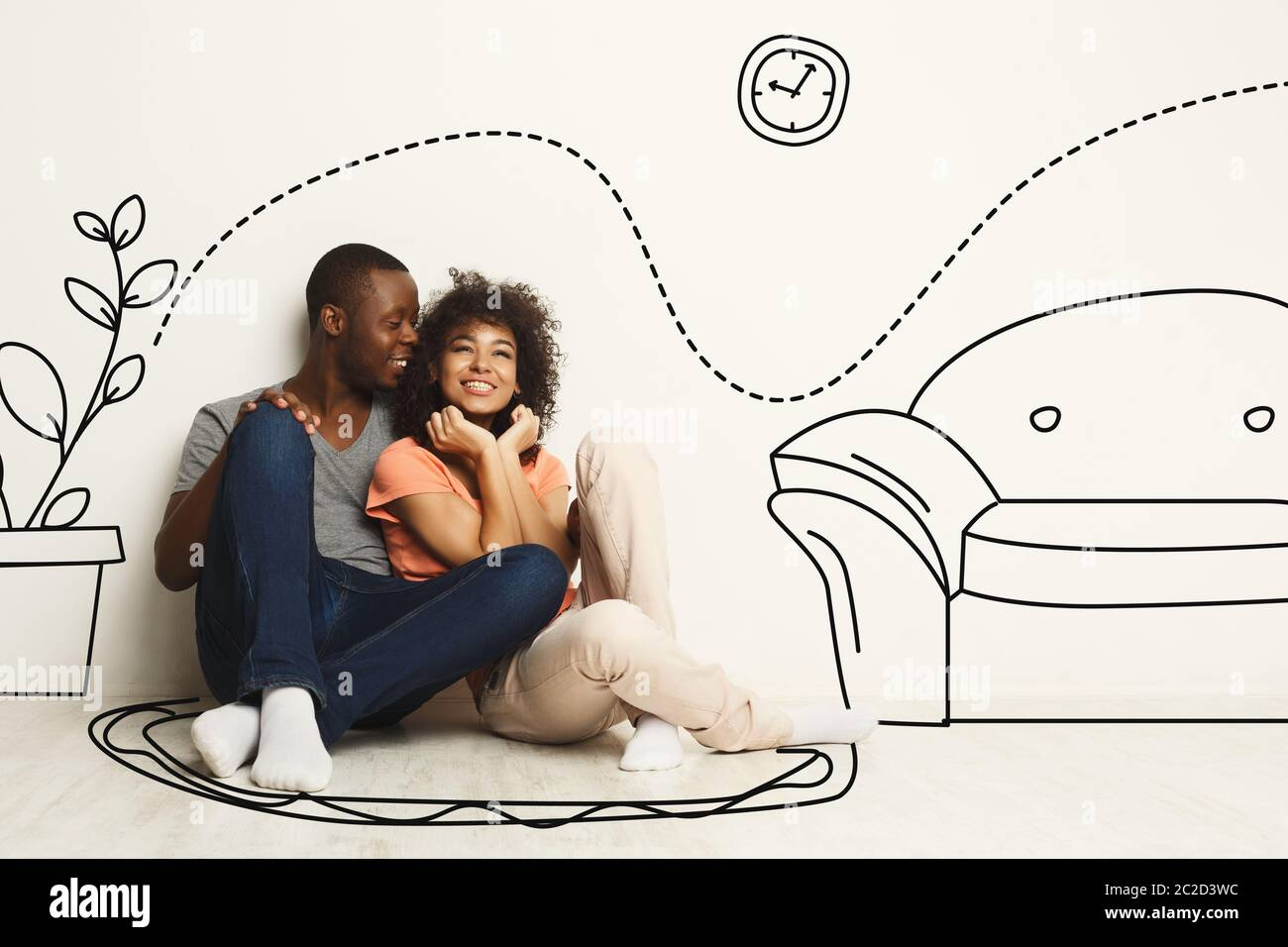 Black guy and his girlfriend imagining new furnished home against white wall with interior drawings Stock Photo