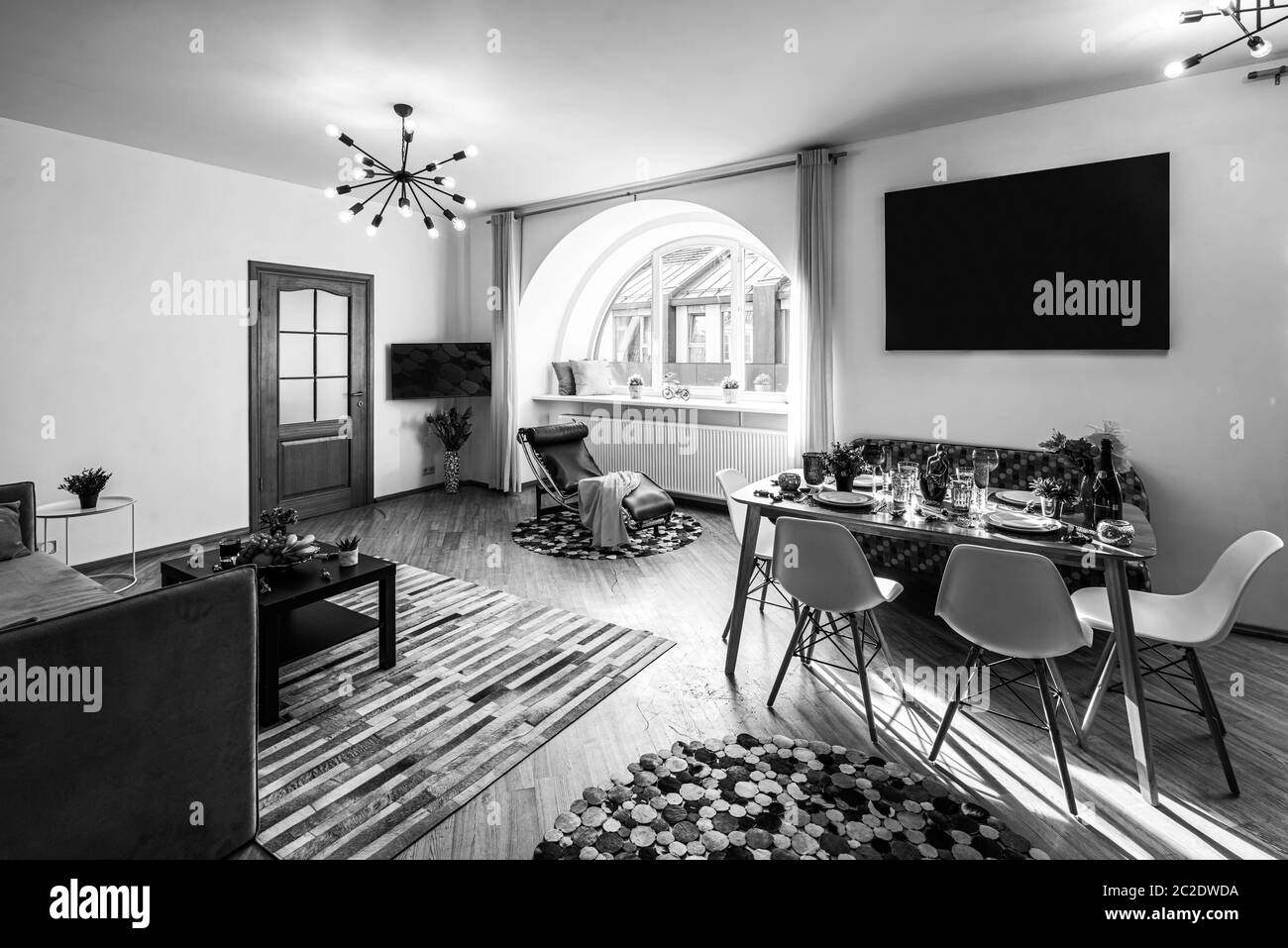 Picture of: Modern Interior Of Living Room In Luxury Apartment Cozy Sofa Set Table And Chairs Semicircle Window Black And White Stock Photo Alamy