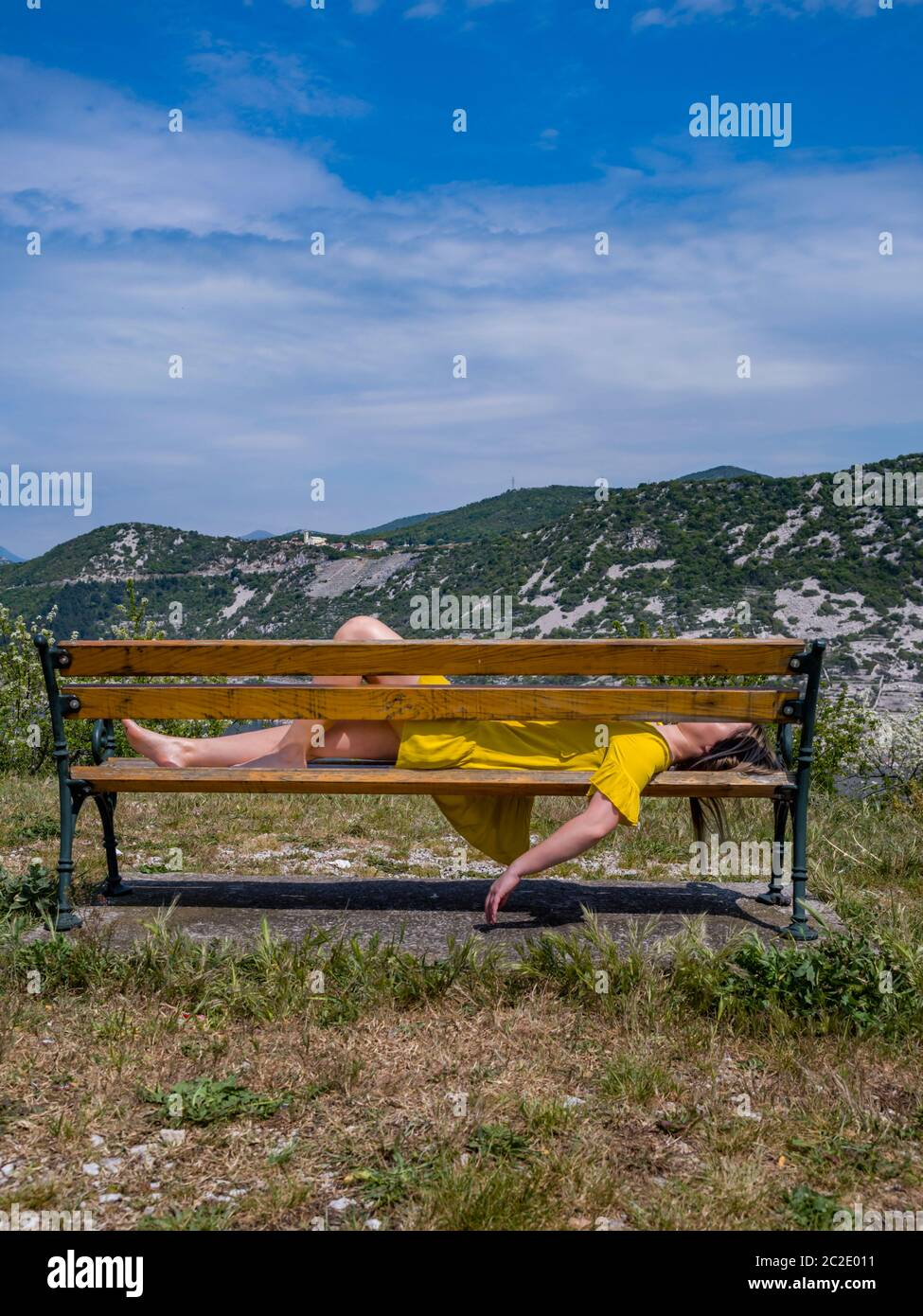 Teengirl resting relaxing tired on park bench sideview side-view Stock Photo