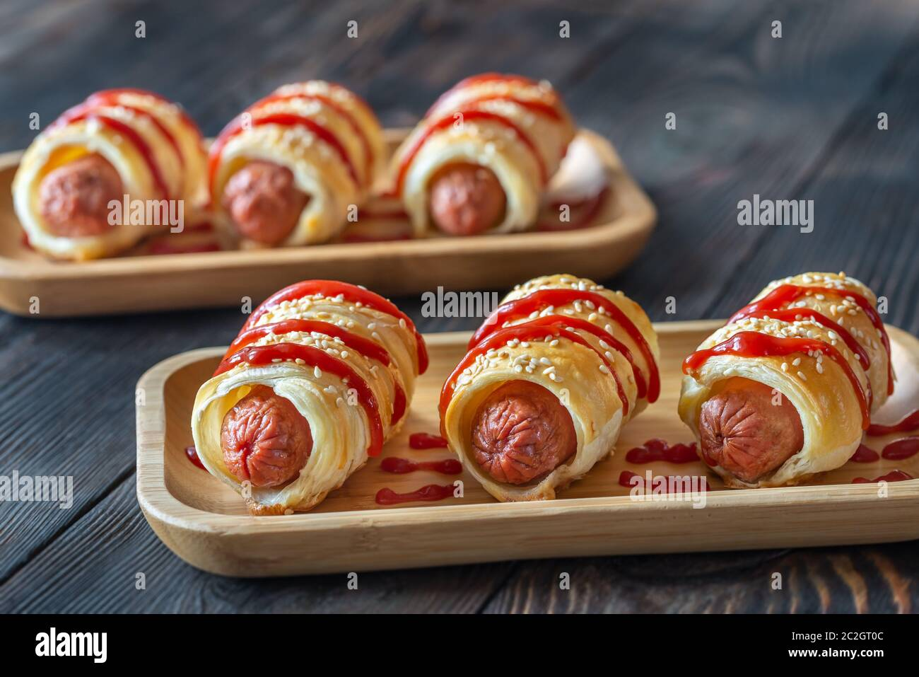 Sausage rolls on the wooden tray: top view Stock Photo