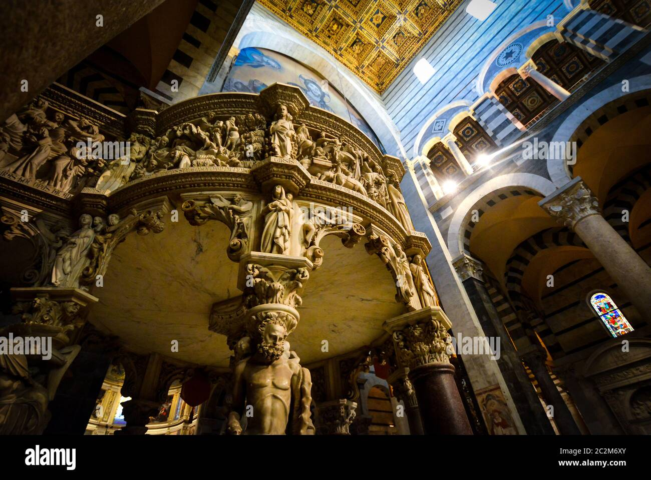 Giovanni Pisano's marble pulpit highlights the interior of the Santa Maria Assunta, Pisa's grand Duomo Cathedral in the Square of Miracles, Italy Stock Photo
