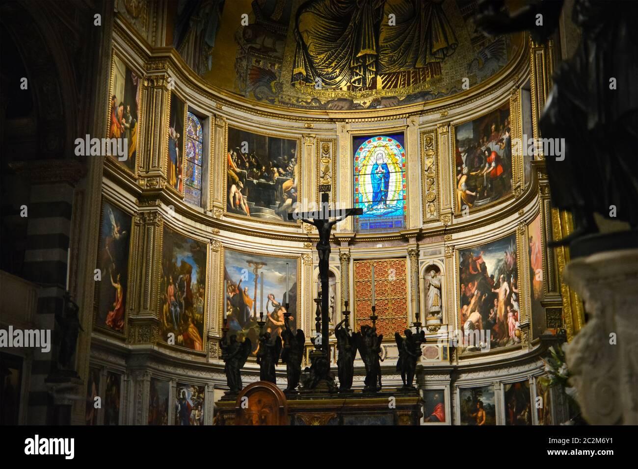 The interior altar featuring renaissance religious artwork of the Pisa Duomo Cathedral or Cattedrale Metropolitana Primaziale di Santa Maria Assunta Stock Photo