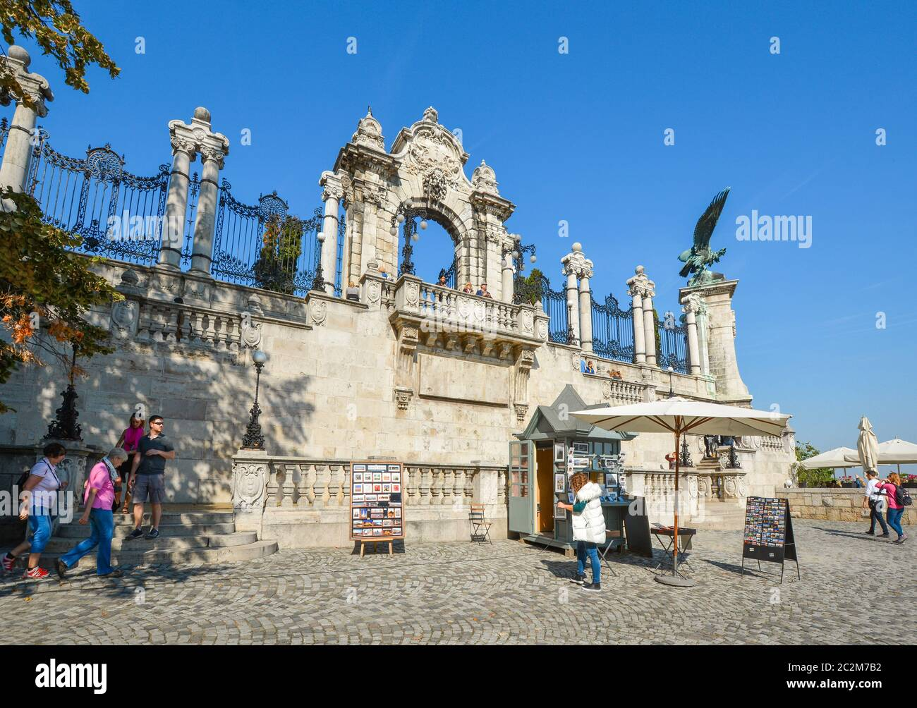 A souvenir vendor sells prints under the Turul statue at the Buda Castle Complex in Budapest, Hungary Stock Photo