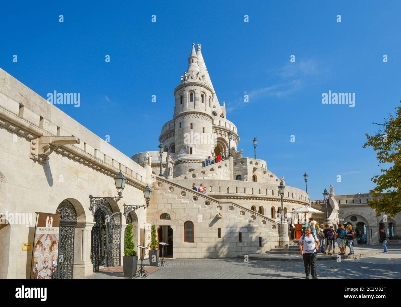 Tourists enjoy a sunny day at Fisherman's Bastion, part of the Buda Castle Complex in Budapest Hungary. Stock Photo