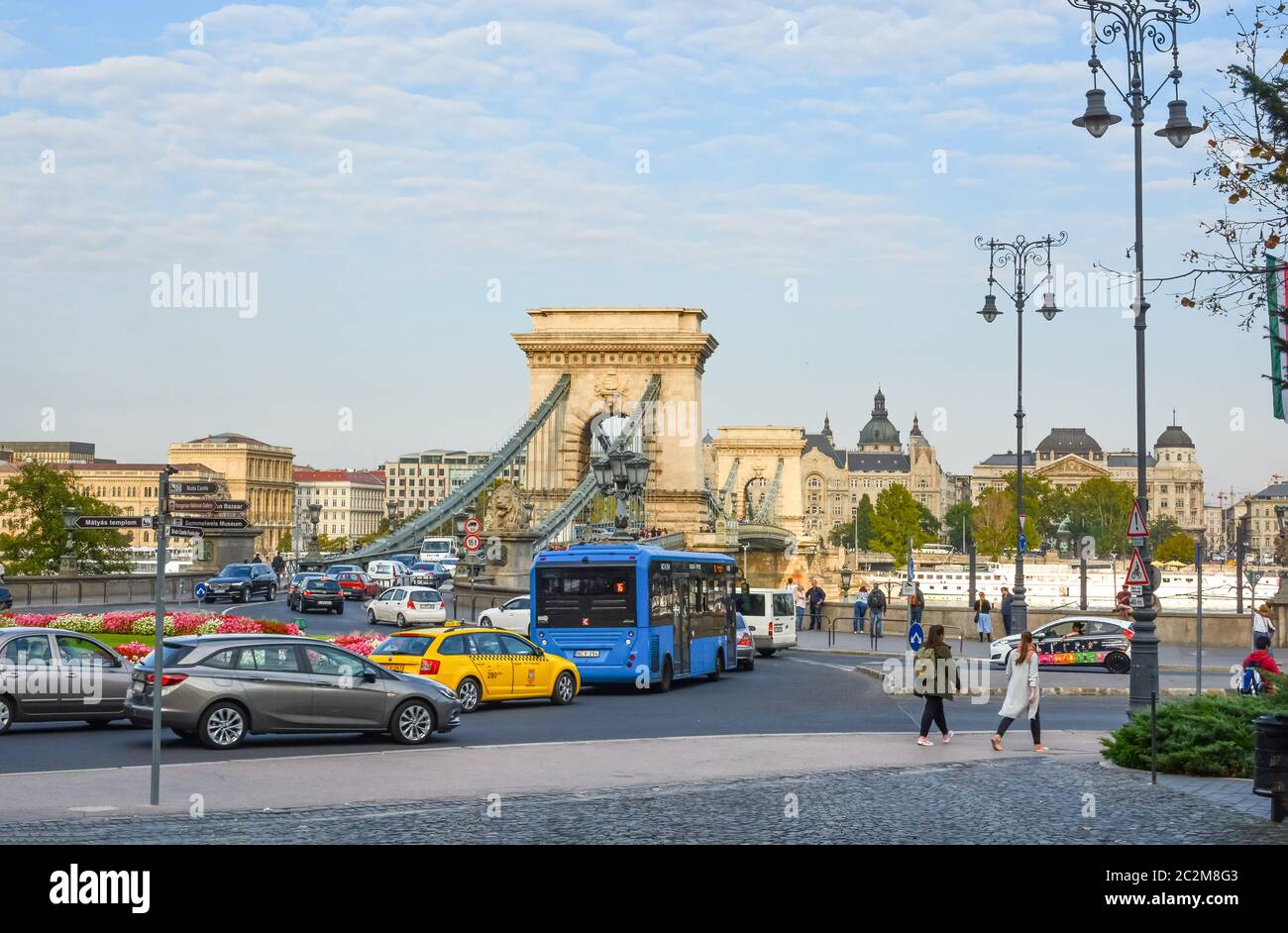 Late afternoon at the traffic roundabout connecting the Buda Castle Complex and the Chain Bridge in Budapest Hungary Stock Photo