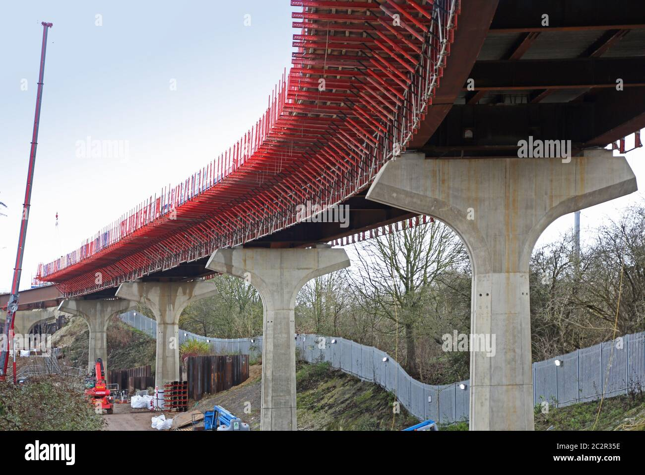 Construction of the new DART rail link from Luton Airport Parkway station to the Airport terminals. Shows concrete columns and steel bridge deck. Stock Photo