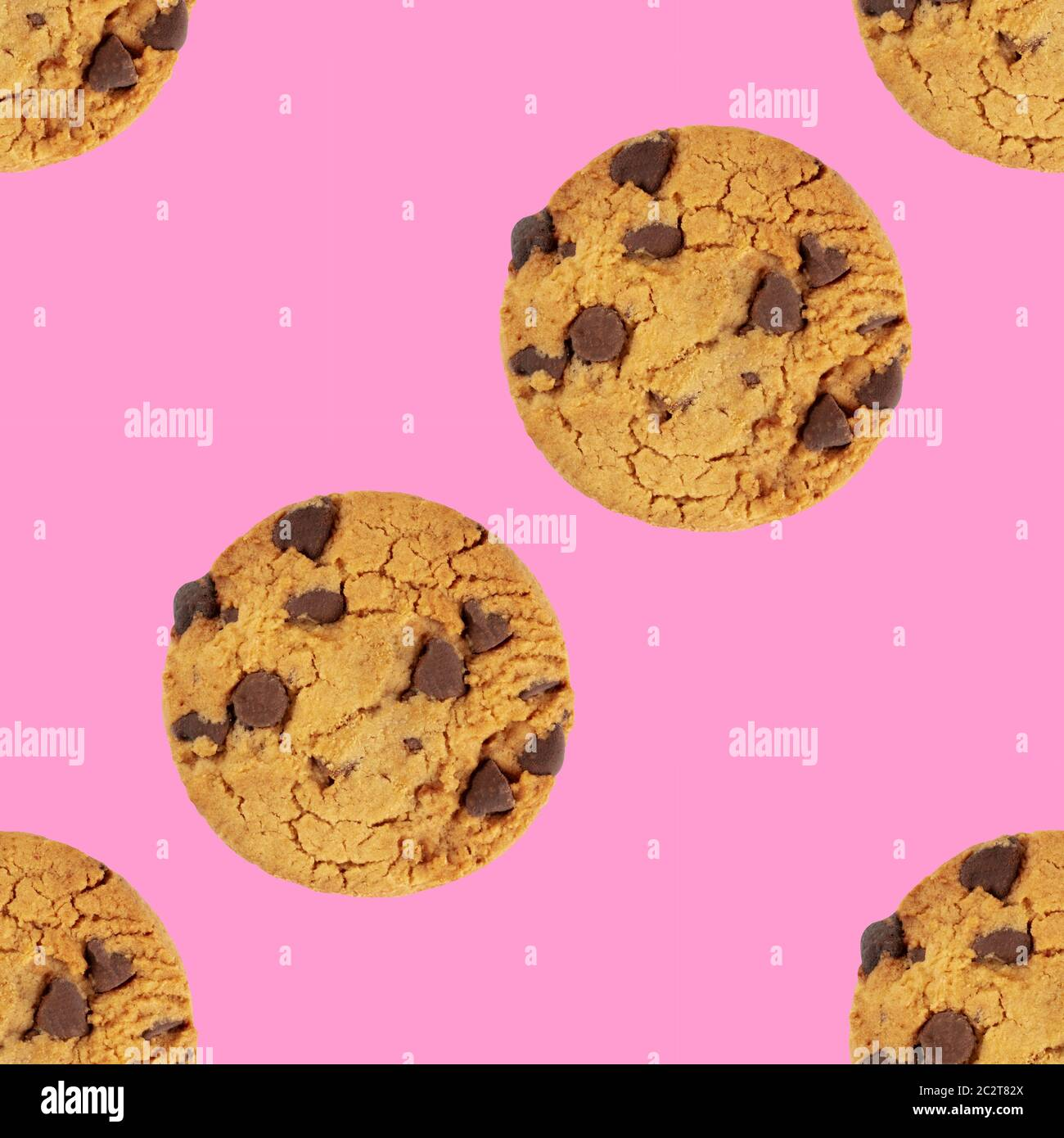 Chocolate chip cookies, gluten free, a seamless repeat pattern on a vibrant pink background Stock Photo