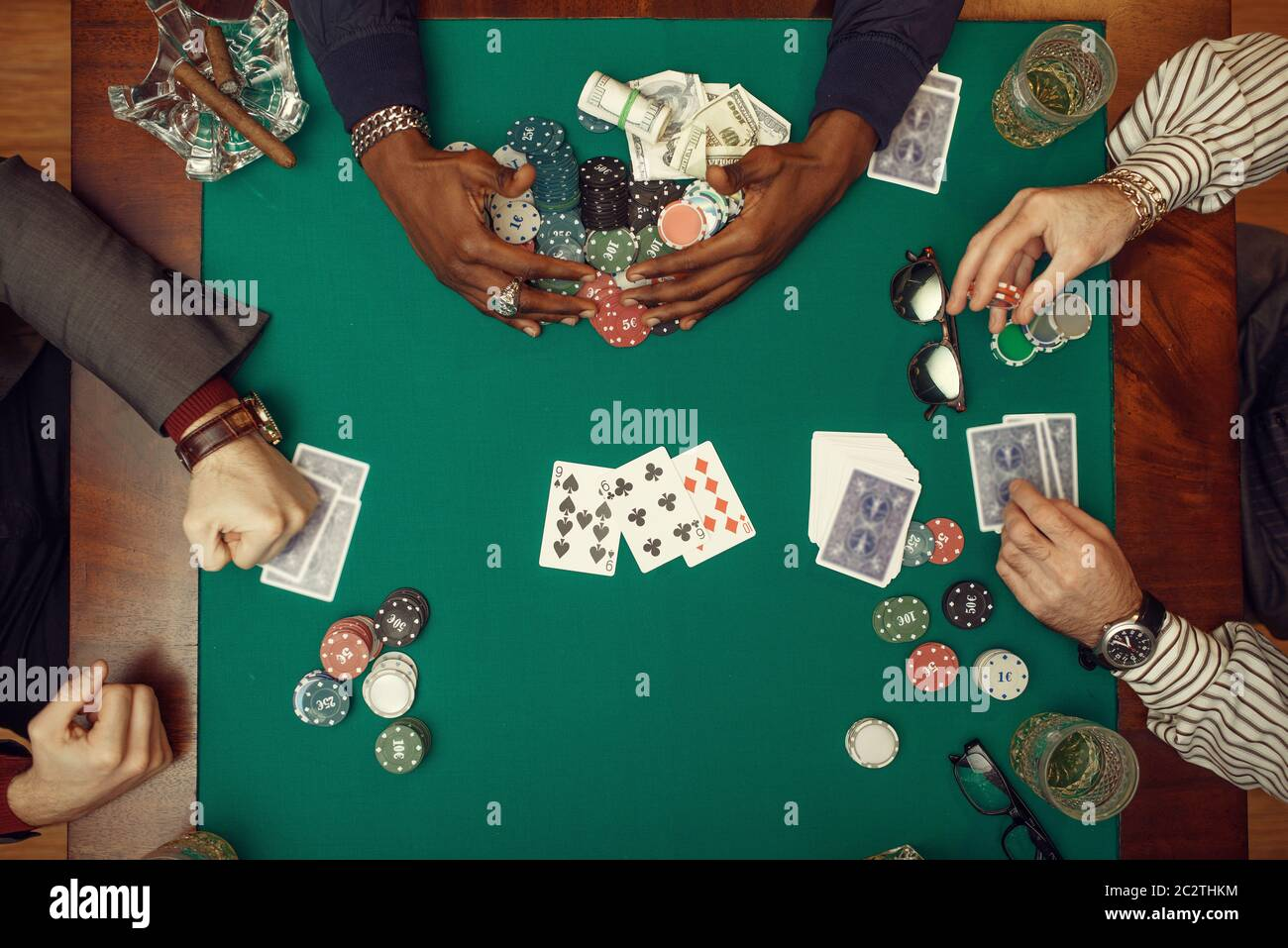Poker Players Hands With Cards Top View Gaming Table With Green
