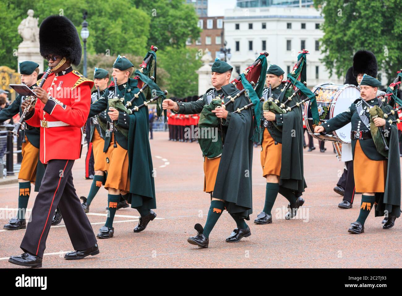 The Regimental Band and Pipers of the Irish Guards marcj at The Colonel's Review ahead of Trooping the Colour in London, England Stock Photo